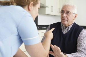 nurse pointing to an older man, nursing home abuse