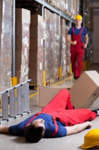 A worker lying on ground, Warehouse slip and fall